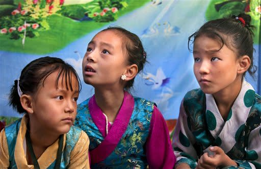 Tibetan schoolgirls wait for the arrival of spiritual leader the Dalai Lama for a function at the Tibetan school in Srinagar, India, Saturday, July 14, 2012. The Dalai Lama is on a four-day visit to the troubled portion of Indian Kashmir. (AP Photo/ Dar Yasin)
