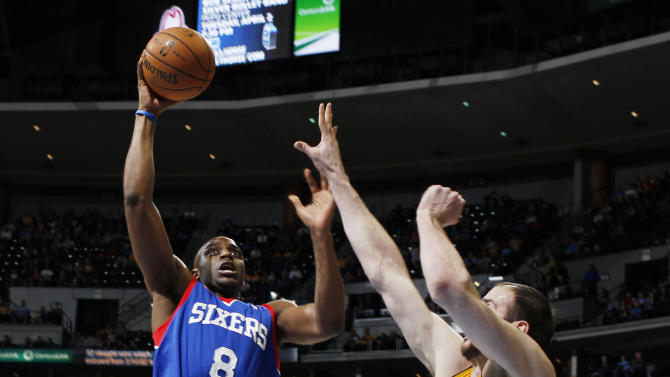 Philadelphia 76ers guard Damien Wilkins, left, drives the lane to shoot as Denver Nuggets forward Kosta Koufos (41) covers in the first quarter of an NBA basketball game in Denver, Thursday, March 21, 2013. (AP Photo/David Zalubowski)