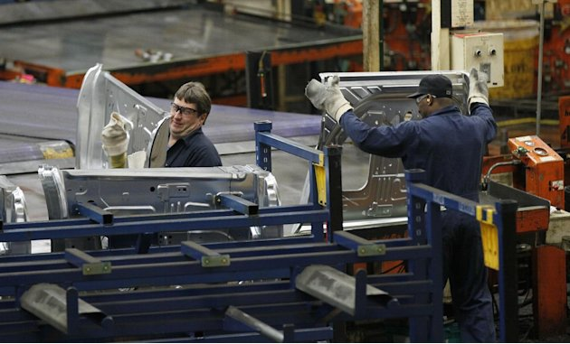 In this April 4, 2012 photo, auto workers at the Ford Stamping Plant stack the inner door panel for the Ford Explorer, in Chicago Heights, Ill. The Labor Department says the economy added 120,000 jobs