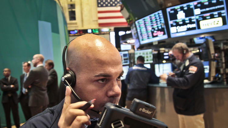 Fred DeMarco, a trader with Bay Crest Partners, talks into a headset during early trading on the floor of the New York Stock Exchange on Tuesday, Nov. 20, 2012.  (AP Photo/Bebeto Matthews)