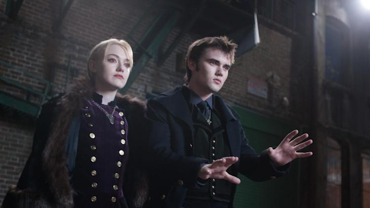 "This film image released by Summit Entertainment shows Dakota Famming, left, and Cameron Bright in a scene from ""The Twilight Saga: Breaking Dawn Part 2."" (AP Photo/Summit Entertainment, Andrew Cooper)  Ph: Andrew Cooper, SMPSP © 2011 Summit Entertainment, LLC.  All rights reserved."