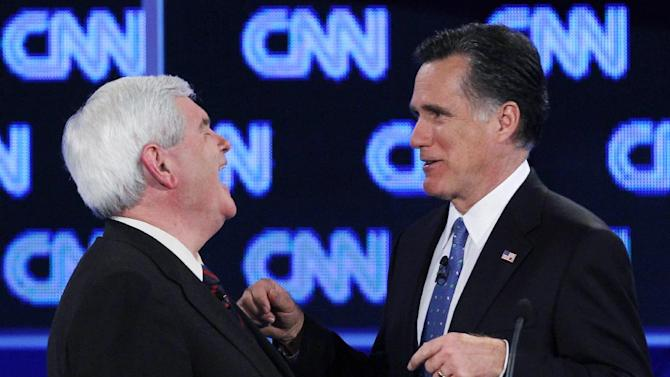 FILE - In this Jan. 26, 2012 file photo, Republican presidential candidates, former House Speaker Newt Gingrich and former Massachusetts Gov. Mitt Romney talk during a commercial break at the Republican presidential candidates debate in Jacksonville, Fla. Confident and forceful, Romney's debate performance scores points with body-language experts. (AP Photo/Matt Rourke, File)