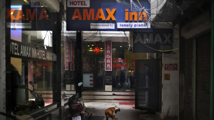 A dog stands outside Hotel Amax Inn in New Delhi Wednesday, Jan. 15, 2014. A 51-year-old Danish tourist lost her way and asked for directions back to this hotel was gang-raped Tuesday near a popular central shopping area in the Indian capital, police said Wednesday. The woman managed to reach her hotel Tuesday evening and the owner called police. The attack is the latest case to focus international attention on the scourge of rape and violence against women in India. (AP Photo/Altaf Qadri)
