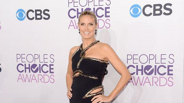 "BEST: Heidi Klum.  Hello, sexy mama! The ""Project Runway"" host may be a mother of four, but still knows how to vamp it up in a Julien McDonald black dress."
