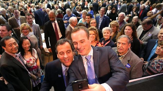New Jersey Gov. Chris Christie poses for a selfie with Bryan Traeger of West Des Moines during Gov. Terry Branstad's birthday bash on Saturday Oct. 25, 2014 in Clive, Iowa. Christie, returning to Iowa to headline one of the biggest events on the state's political calendar, criticized President Barack Obama in a fiery speech Saturday night that sounded like the early makings of a presidential pitch. (AP Photo/The Des Moines Register, Bryon Houlgrave)
