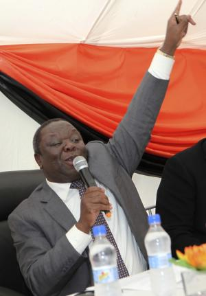 FILE - In this Wednesday, June 12, 2013, file photo, Zimbabwean Prime Minster Morgan Tsvangirai gestures during a press briefing with civic society leaders in Harare. Tsvangirai said Friday, July 26, 2013 he is deeply disturbed by chaotic preparations for Zimbabwe's elections on July 31 despite the African Union's approval of the process. (AP Photo/Tsvangirayi Mukwazhi, File)
