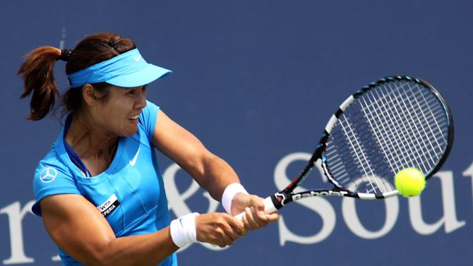 Li Na, of China, returns a volley to Johanna Larsson, of Sweden, during a match at the Western & Southern Open tennis tournament, Friday Aug. 17, 2012, in Mason, Ohio. (AP Photo/Tom Uhlman)