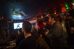 People watch the NFC championship football game between the Seattle Seahawks and the San Francisco 49ers in Jersey City