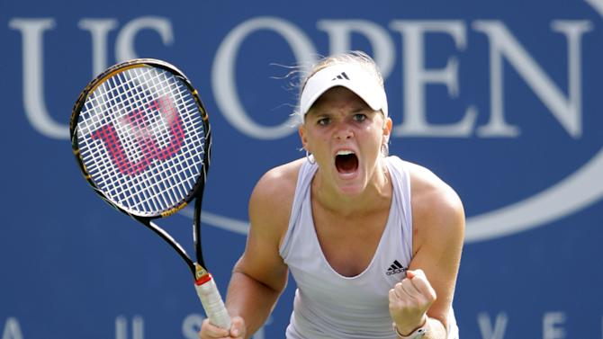 """FILE- In this  Sept. 7, 2009, file photo, Melanie Oudin, of the United States, reacts during her match against Nadia Petrova, of Russia, at the U.S. Open tennis tournament in New York. Oudin says her problems with her heart have returned, pushing back her start to the season.  Oudin, a surprise quarterfinalist at the 2009 U.S. Open at age 17, wrote Thursday on Twitter that she """"will probably have to undergo another procedure"""" for a heart condition. (AP Photo/Amy Sancetta, File)"""