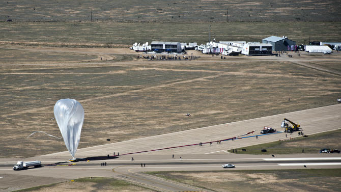 In this photo provided by Red Bull Stratos, the  55-story, ultra-thin helium balloon that was to carry extreme athlete Felix Baumgartner to his 23-mile free fall twists in the wind Tuesday, Oct. 9, 2012 in Roswell, N.M.  A 25 mph gust of wind rushed so fast that it spun the still-inflating balloon as if it was a giant plastic grocery bag, raising concerns at mission control about whether it was damaged from the jostling. The jump will be postponed until at least Thursday. (AP Photo/Red Bull Stratos, Predrag Vuckovic)