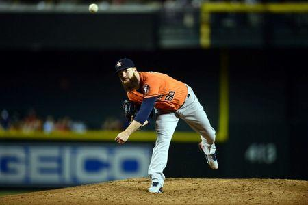 Astros stay alive in AL West race, Keuchel notches 20th win
