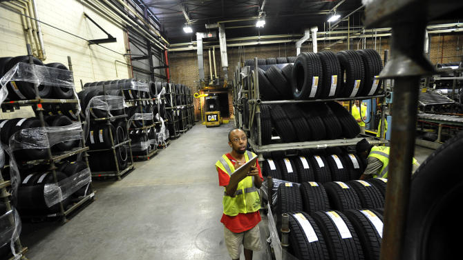 FILE-In this Tuesday, July 24, 2012, file photo, forklift driver Clyde Boyce takes inventory in the warehouse at a Michelin tire manufacturing plant in Greenville, S.C. U.S. worker productivity grew at the same modest rate this summer as in spring, a sign that companies may be nearing the limits on how much output they can get from their employees.The Labor Department said Thursday, Nov. 1, 2012,  that worker productivity increased at a modest 1.9 percent annual rate from July through September, matching the April-June quarter rate. Labor costs fell at a 0.1 percent rate after having risen at a 1.7 percent rate in the second quarter.  (AP Photo/Rainier Ehrhardt, File)