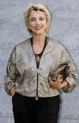 "FILE - In this, Monday, Sept. 22, 2008 file photo, Italian actress Mariangela Melato smiles to photographers prior to the start of the Giorgio Armani Spring/Summer 2009 fashion collection, presented in Milan, Italy. Melato, 71, known for her critically acclaimed performance as a spoiled socialite stranded with a sailor she had tormented in the 1974 film comedy ""Swept Away"" has died in a Rome hospital. The Antea hospital said she died Friday, Jan. 11, 2013. The LaPresse news agency said she was suffering from pancreatic cancer. The blonde actress obtained her most success in a series of films in the 1970s directed by the Italian Lina Wertmuller, including ""The Seduction of Mimi"" and ""Love and Anarchy."" (AP Photo/Luca Bruno, File)"