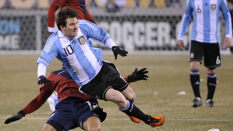 Argentina's Lionel Messi (10) is tripped up by United States' Jermaine Jones during the first half of an friendly soccer match Saturday, March 26, 2011 at New Meadowands Stadium in East Rutherford, N.J. (AP Photo/Bill Kostroun)
