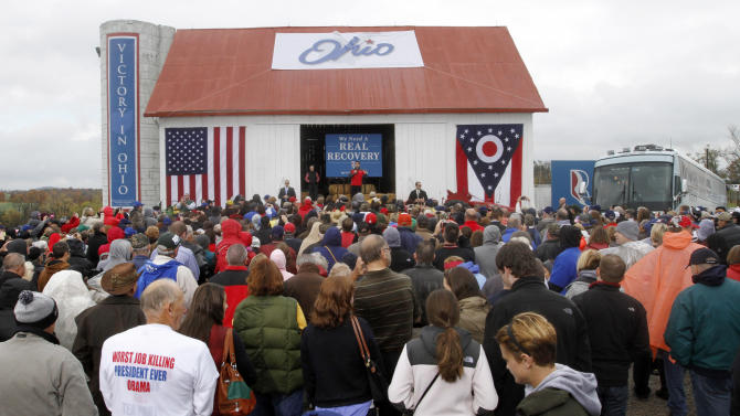 FILE - In this Oct. 20, 2012, file photo, Republican vice presidential candidate Rep. Paul Ryan, R-Wis., on stage in red, speaks at a campaign rally at Valley View Campgrounds in Belmont, Ohio. Ryan is telling Ohio voters that he feels right at home in their small towns and farms. As Ryan traipses through Ohio, he is doing everything he can to sell himself as the neighbor up the block who just happens to be the Republican vice presidential nominee. Look for that approach to continue in the campaign's final week, as Ryan tries to connect with working class voters who are skeptical of running mate Mitt Romney's vast personal wealth or who aren't sure they are ready to vote President Barack Obama out of office.  (AP Photo/Keith Srakocic, File)