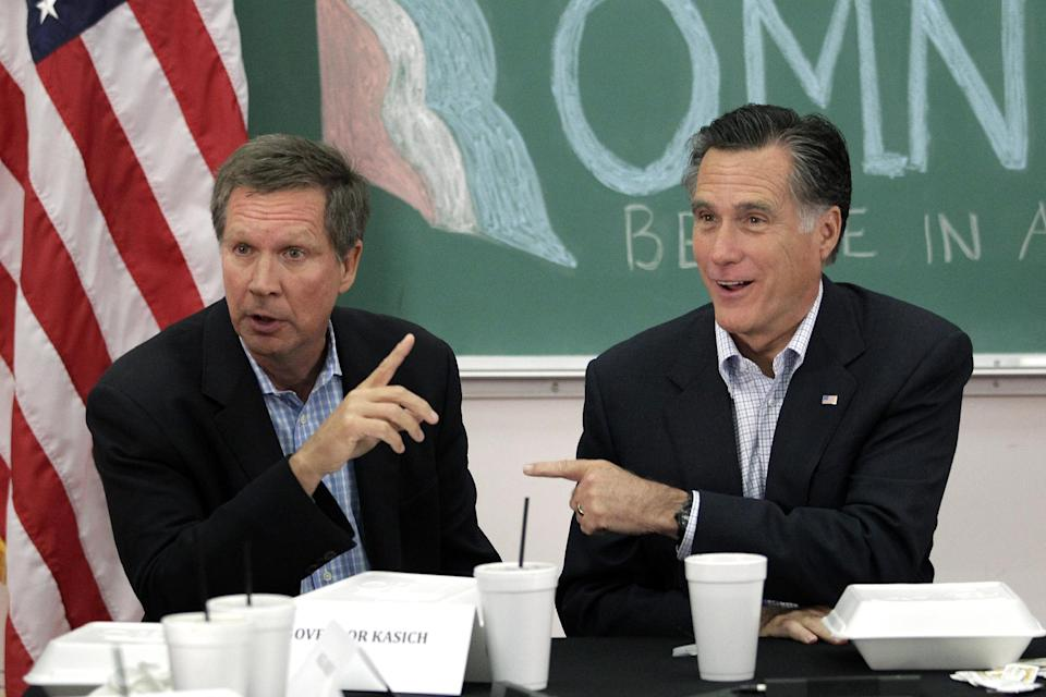 Republican presidential candidate, former Massachusetts Gov. Mitt Romney and Ohio Gov. John Kasich point to each other during a roundtable discussion with students at Otterbein University in Westerville, Ohio, Friday, April 27, 2012. (AP Photo/Jae C. Hong)