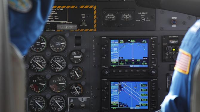FILE - In this July 10, 2010, a cockpit GPS shows the search area as scientists participate in a marine mammal/sea turtle survey flight related to the Deepwater Horizon oil spill on a National Oceanic and Atmospheric Administration twin otter DHC-6, over the Gulf of Mexico near the Chandeleur Islands off the Louisiana coast. The Federal Communications Commission said it will seek public comment as early as Wednesday, Feb. 15, 2012, on revoking LightSquared's permit after a federal agency that coordinates wireless signals, the National Telecommunications and Information Administration, concluded that there's no way to mitigate potential interference. (AP Photo/Gerald Herbert, file)