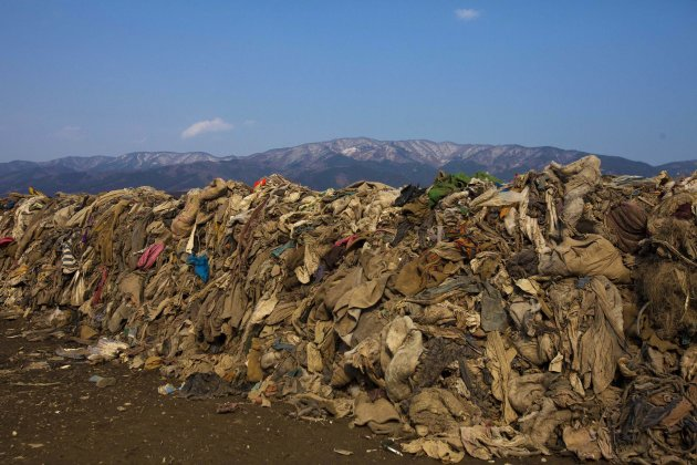 FILE  - This file photo taken Tuesday Feb. 21, 2012 shows clothing lying in heaps at the site of a neighborhood destroyed by the 2011 earthquake and tsunami, in Rikuzentakata, Japan. Scientists believ