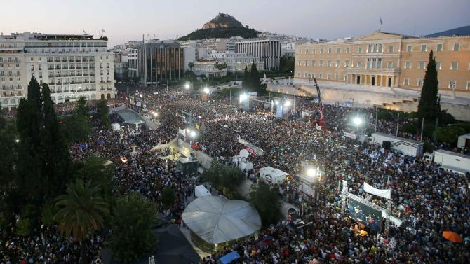 Demonstrators gather in front of the Greek parliament building in Syntagma Square in Athens to attend an anti-Austerity rally