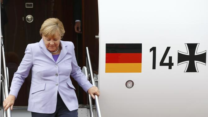 German Chancellor Merkel disembarks a Bombadier Global 5000 at the airport of the Swiss capital Bern