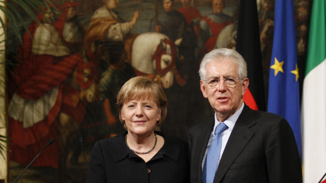 Italian Prime Minister Mario Monti, right, shakes hands with German Chancellor Angela Merkel during a press conference at Palazzo Chigi's government office, in Rome, Tuesday, March 13, 2012. Italian Premier Mario Monti, flanked by German leader Angela Merkel, says European Union focus must be on economic growth, even as the acute financial crisis seems to be easing. Monti, at a news conference with Merkel after the two held private talks in Rome Tuesday, said the EU must give the same attention to growth as it has to the debt crisis. (AP Photo/Alessandra Tarantino)