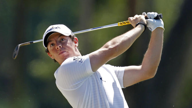 Rory McIlroy, of Northern Ireland, hits from the seventh fairway during the first round of the Players Championship golf tournament on Thursday, May 10, 2012, at Sawgrass in Ponte Vedra Beach, Fla. (AP Photo/Chris O'Meara)