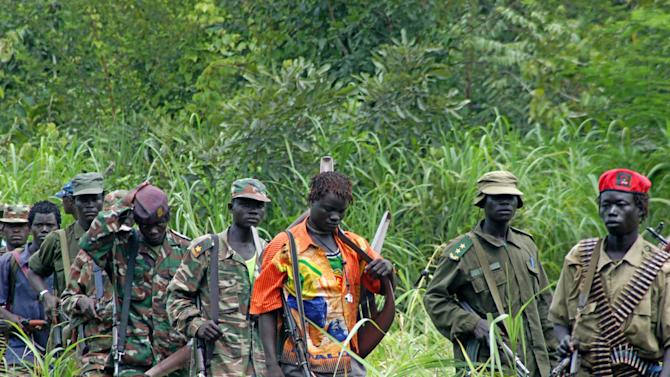 FILE - In this July 31, 2006 file photo, members of Uganda's Lord's Resistance Army (LRA) are seen as their leader Joseph Kony meets with a delegation of Ugandan officials and lawmakers and representatives from non-governmental organizations, in the Democratic Republic of Congo near the Sudanese border. Adventurer Robert Young Pelton, whose crowd-funding scheme has already drawn criticism from a pair of Africa experts, is the latest to join a line of private individuals and aid groups who are trying to corner Joseph Kony and the members of his Lord's Resistance Army. (AP Photo, File)
