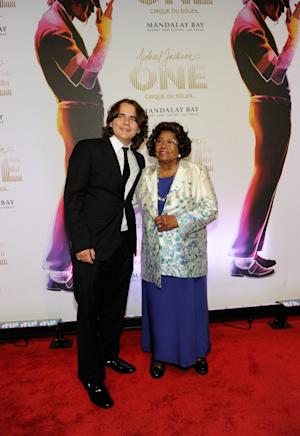 """FILE - In this June 29, 2013 file photo, Prince Jackson, left, and Katherine Jackson arrive at the world premiere of """"Michael Jackson ONE"""" at THEhotel at Mandalay Bay Resort and Casino, in Las Vegas. A Los Angeles jury will have to considering how much to award Jackson's three children and mother if they determine that concert promoter AEG Live LLC hired the doctor convicted of causing the superstar's June 2009 death. Deliberations are expected to begin on Thursday, Sept. 26, 2013, after a 21 week trial that has revealed many of Michael Jackson's ambitions, including a new career in filmmaking. (Photo by David Becker/Invision/AP, File)"""