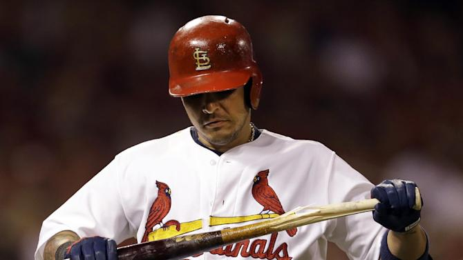 St. Louis Cardinals' Yadier Molina breaks his bat after flying out to end the third inning of a baseball game against the Cincinnati Reds Friday, Sept. 19, 2014, in St. Louis. (AP Photo/Jeff Roberson)