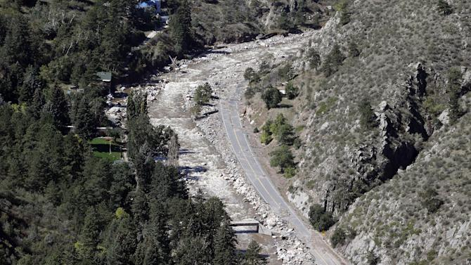 A section of highway is pictured near Boulder, Colo., on Monday, Sept. 23, 2013, during a tour of the area with Vice President Joe Biden. (AP Photo/Ed Andrieski)y