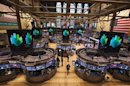 Traders work after the closing bell on the floor of the New York Stock Exchange