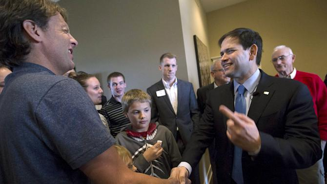 U.S. Presidential candidate and Republican Senator of Florida Marco Rubio greets attendees during a campaign event in Ankeny