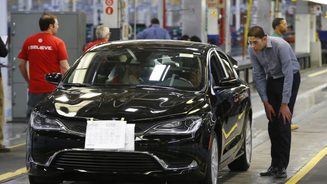 FILE - In this March 14, 2014 file photo, a 2015 Chrysler 200 automobile rolls down the assembly line at the Sterling Heights Assembly Plant in Sterling Heights, Mich. The major automakers release sales for September on Wednesday, Oct. 1, 2014. (AP Photo/Paul Sancya, File)
