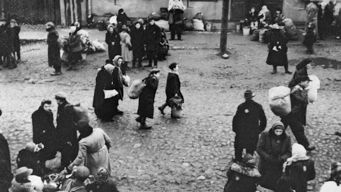 """In this October 26, 1943 photo provided by the United States Holocaust Memorial Museum courtesy of George Kadish/Zvi Kadushin, Jews are gathered at an assembly point in the Kaunas ghetto in Kanuas, Lithuania for a deportation action, most likely to Estonia. Despite all the Holocaust writings, more news is emerging about 1,000 Nazi-run ghettos that left millions of Jews dead. """"Encyclopedia of Camps and Ghettos, 1933-1945, Volume II""""  is a global effort that documents every site of organized Nazi atrocities. (AP Photo/United States Holocaust Memorial Museum) MANDATORY CREDIT: UNITED STATES HOLOCAUST MEMORIAL MUSEUM. ONE TIME USE ONLY, NO ARCHIVING"""