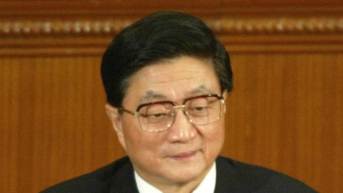 FILE - In this March 17, 2003 file photo, new Chinese Vice Premier Huang Ju sits during a session of the National People's Congress in which he was appointed to his new job in Beijing. Huang lectured Chinese bankers in early 2006 on the importance of government control over state banks. Then he dropped from sight. Nearly two months passed before a Chinese official said vaguely that Huang had been unwell and was convalescing in hospital. Media were banned from reporting on his condition. Because of his illness, Huang, a key ally of former Chinese President Jiang Zemin, had been expected to retire in the fall of 2007. He died four months earlier. The official announcement of his death gave no cause, though reports say he had pancreatic cancer. (AP Photo/Greg Baker, File)