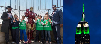 "World-Famous Avenger, Iron Man, joined Police Athletic League (PAL) kids atop the Empire State Building which was lit in green and white on Thursday, May 29 to celebrate PAL's centennial. Joining Iron Man and the PAL kids were JD Michaels (far left, SVP, Director of Tactile Production and Creative Engineering, BBDO NY) and Marcel Braithwaite (far right, PAL Director of Center Operations). Both were on hand as part of the launch of a new Avengers comic book, ""Heroes Welcome,"" created by BBDO New York..."
