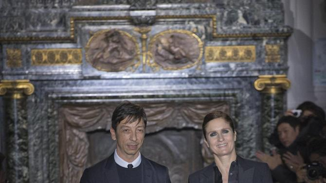 Fashion designers Maria Grazia Chiuri, right,  and Pier Paolo Piccioli appear at the end of the Valentino Fashion show for men's Spring Summer 2013 Haute Couture fashion collection presented in Paris, Wednesday Jan. 16. 2013. (AP Photo/Jacques Brinon)