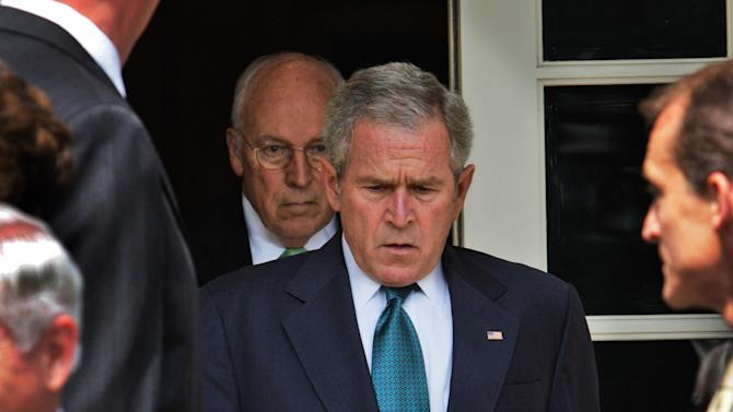 """This July 30, 2008 file photo shows President Bush, followed by Vice President Dick Cheney, as he leaves the Cabinet Room of the White House in Washington, to make a statement in the Rose Garden following a Cabinet meeting in Washington, D.C.  """"The World According to Dick Cheney"""" is included in the documentary premieres at the upcoming 2013 Sundance Film Festival in January.  (AP Photo/Ron Edmonds, File)"""