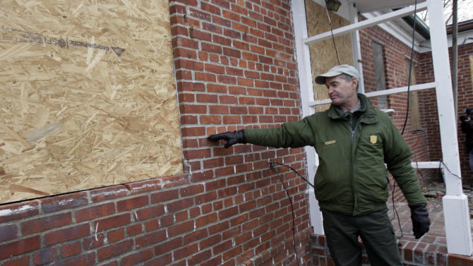 David Luchsinger, superintendent of Statue of Liberty National Monument, and last resident of Liberty Island, shows the high water line at the back of his Superstorm Sandy-damaged home, on Liberty Island in New York, Friday, Nov. 30, 2012. Tourists in New York will miss out for a while on one of the hallmarks of a visit to New York _ seeing the Statue of Liberty up close. Though the statue itself survived Superstorm Sandy intact, damage to buildings and Liberty Island's power and heating systems means the island will remain closed for now, and authorities don't have an estimate on when it will reopen. (AP Photo/Richard Drew)