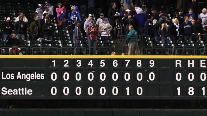 The scoreboard is seen after the Seattle Mariners beat the Los Angeles Dodgers in a baseball game Friday, June 8, 2012, in Seattle. The Mariners won 1-0 in a six-pitcher combined no-hitter. (AP Photo/Elaine Thompson)