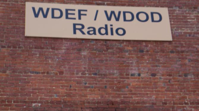 In this July 30, 2012 photo, Luther Masingill poses outside the Chattanooga, Tenn., offices of WDEF, the station where he has worked for 72 years. Masingill, 90, became beloved by using the power of radio to help people find lost dogs. The Tennessee Radio Hall of Fame included him in its initial class of inductees this spring, and he is one of seven professionals to be inducted into the National Radio Hall of Fame in Chicago in November. (AP Photo/Erik Schelzig)
