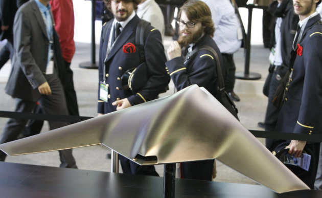 Visitors take a look at a model of Dassault's combat drone nEUROn, during the Paris Air Show, at Le Bourget airport, north of Paris, Wednesday June 22, 2011. (AP Photo/Remy de la Mauviniere)