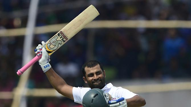 Bangladesh cricketer Tamim Iqbal celebrates after scoring a double century during the final day of the first Test match against Pakistan in Khulna, on May 2, 2015