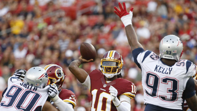 Brady sits; RG3 gets a series as Redskins top Pats