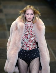 A model presents a creation for Saint Laurent during the Fall/Winter 2013-2014 ready-to-wear collection show on March 4, 2013 in Paris