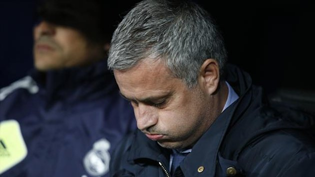 Real Madrid's coach Jose Mourinho concentrates before the start of their Spanish King's Cup final soccer match against Atletico Madrid at Santiago Bernabeu stadium in Madrid May 17, 2013. REUTERS