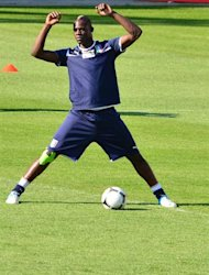 Italian forward Mario Balotelli stretches during a training session  in Krakow on June 16, 2012, two days ahead of the team&#39; Euro 2012 football championships third match . AFP PHOTO / GIUSEPPE CACACE