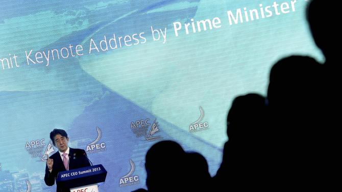 Japan's Prime Minister Shinzo Abe delivers his keynote address at the Asia-Pacific Economic Cooperation (APEC) CEO Summit in Bali, Indonesia, Monday, Oct. 7, 2013 . (AP Photo/Wong Maye-E)
