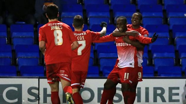 Leyton Orient'sMoses Odubajo (11) celebrates scoring the opening goal against Shrewsbury Town with Kevin Lisbie (right) (PA Photos)
