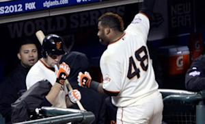 Pablo Sandoval of the San Francisco Giants celebrates with a curtain call after hitting a solo home run in Game 1 of the World Series against the Detroit Tigers. Sandoval went on to hit two more home runs, helping the Giants win 8-3.